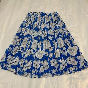 Blue and white floral pleated midi skirt.